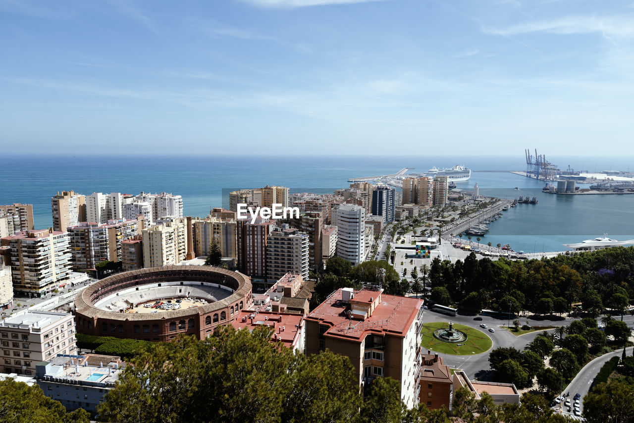 High angle view of buildings and sea against sky