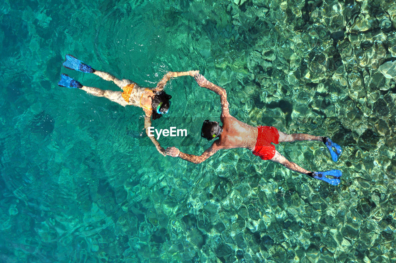 High Angle View Of People Snorkeling In Sea