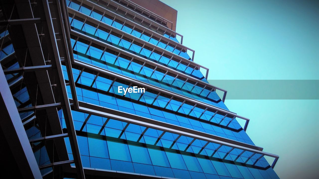 architecture, low angle view, built structure, modern, blue, clear sky, no people, building exterior, day, outdoors, sky