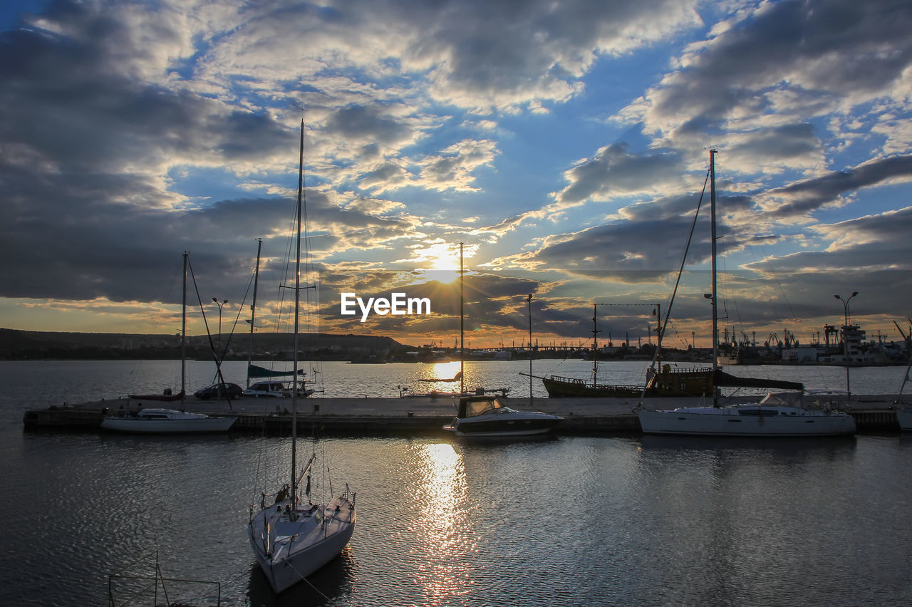 nautical vessel, cloud - sky, transportation, water, mode of transportation, sky, sunset, sailboat, sea, moored, beauty in nature, mast, no people, pole, nature, scenics - nature, harbor, tranquility, tranquil scene, outdoors, marina, yacht