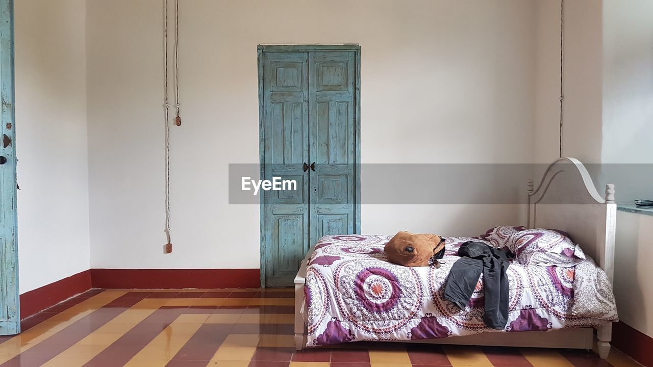 bed, furniture, door, indoors, home interior, entrance, bedroom, absence, domestic room, no people, house, window, day, flooring, pillow, architecture, home, open, doorway, home showcase interior