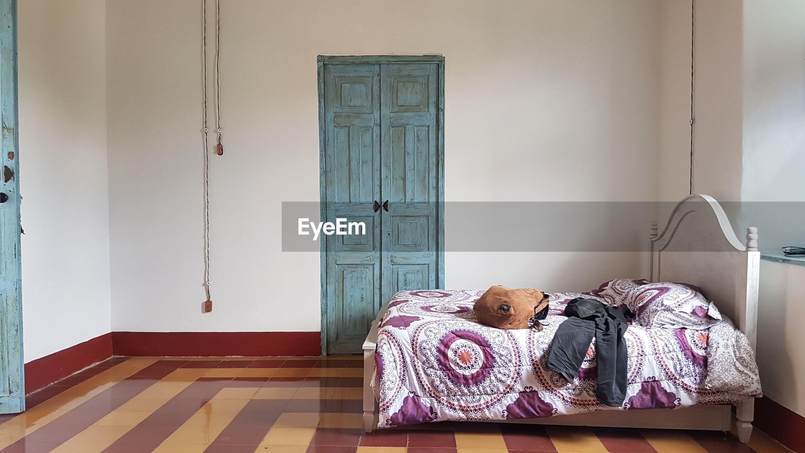 OPEN DOOR ON BED