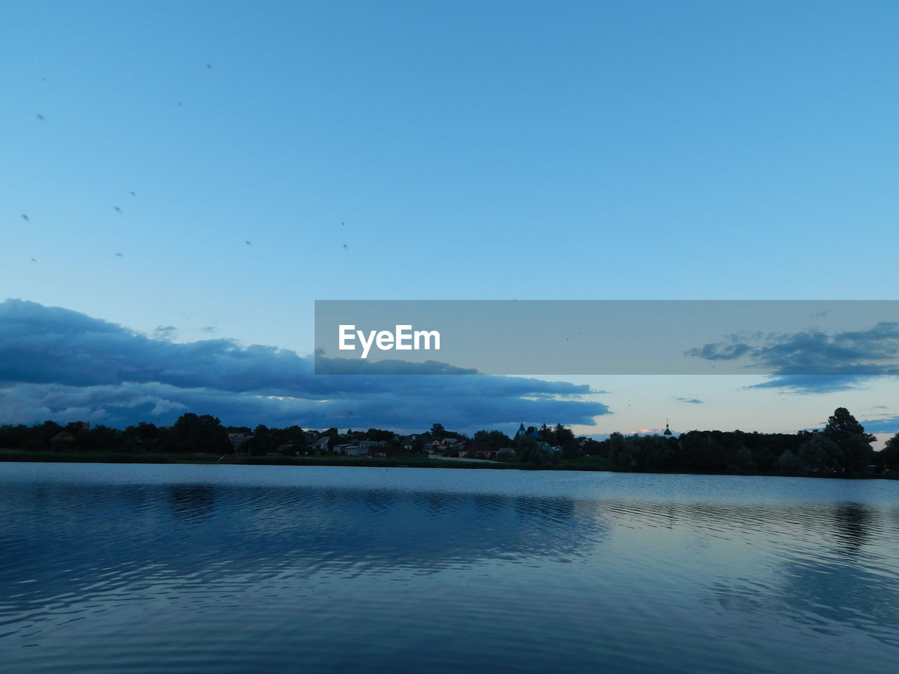 sky, water, tranquil scene, beauty in nature, tranquility, tree, scenics - nature, waterfront, lake, plant, blue, nature, reflection, no people, non-urban scene, idyllic, copy space, cloud - sky, outdoors