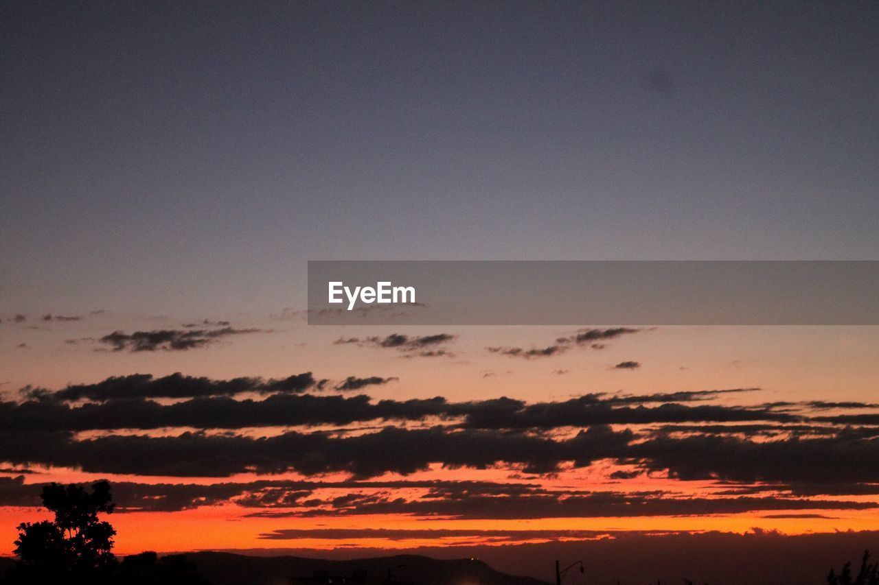 sky, sunset, cloud - sky, beauty in nature, scenics - nature, tranquility, tranquil scene, orange color, silhouette, nature, no people, copy space, idyllic, outdoors, low angle view, environment, dramatic sky, landscape, non-urban scene, dusk, romantic sky