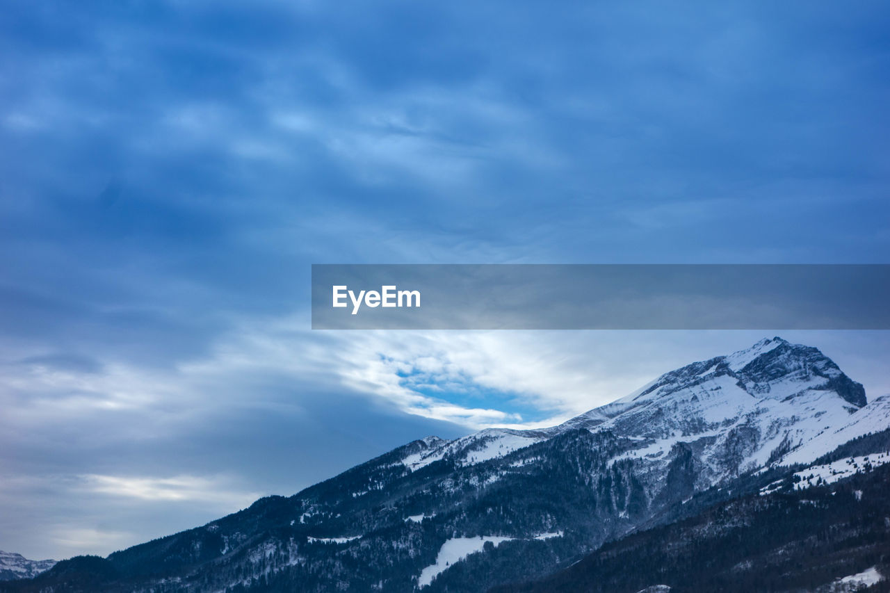 snow, mountain, cold temperature, winter, nature, weather, sky, beauty in nature, scenics, tranquil scene, snowcapped mountain, cloud - sky, mountain range, tranquility, no people, landscape, outdoors, day, range
