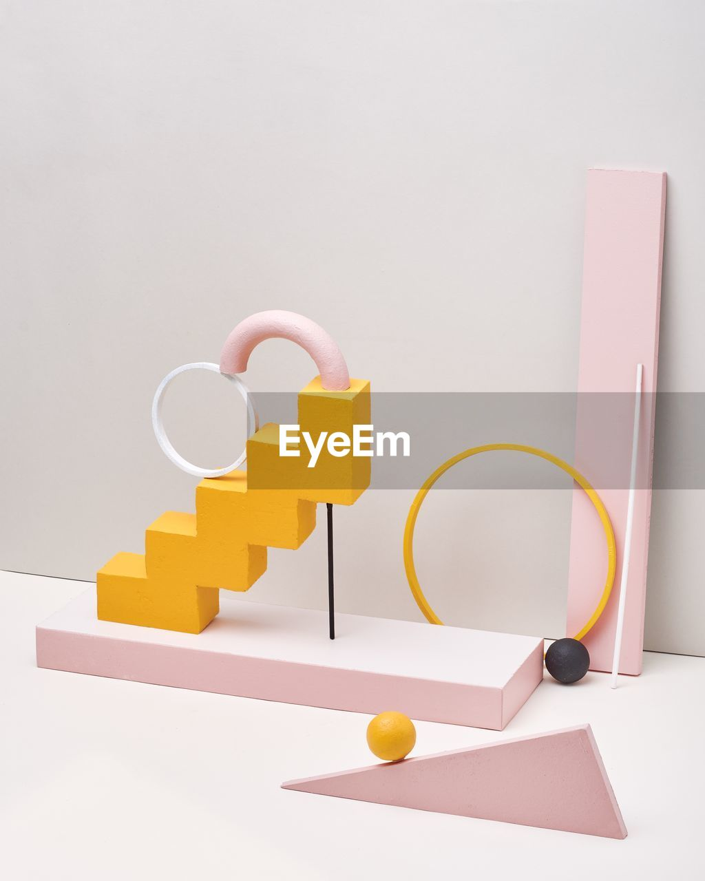 indoors, studio shot, still life, no people, white background, copy space, communication, table, connection, paper, multi colored, close-up, text, choice, group of objects, yellow, geometric shape, capital letter, pink color