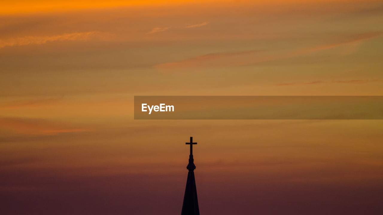 Cross On Top Of Church Against Sky During Sunset