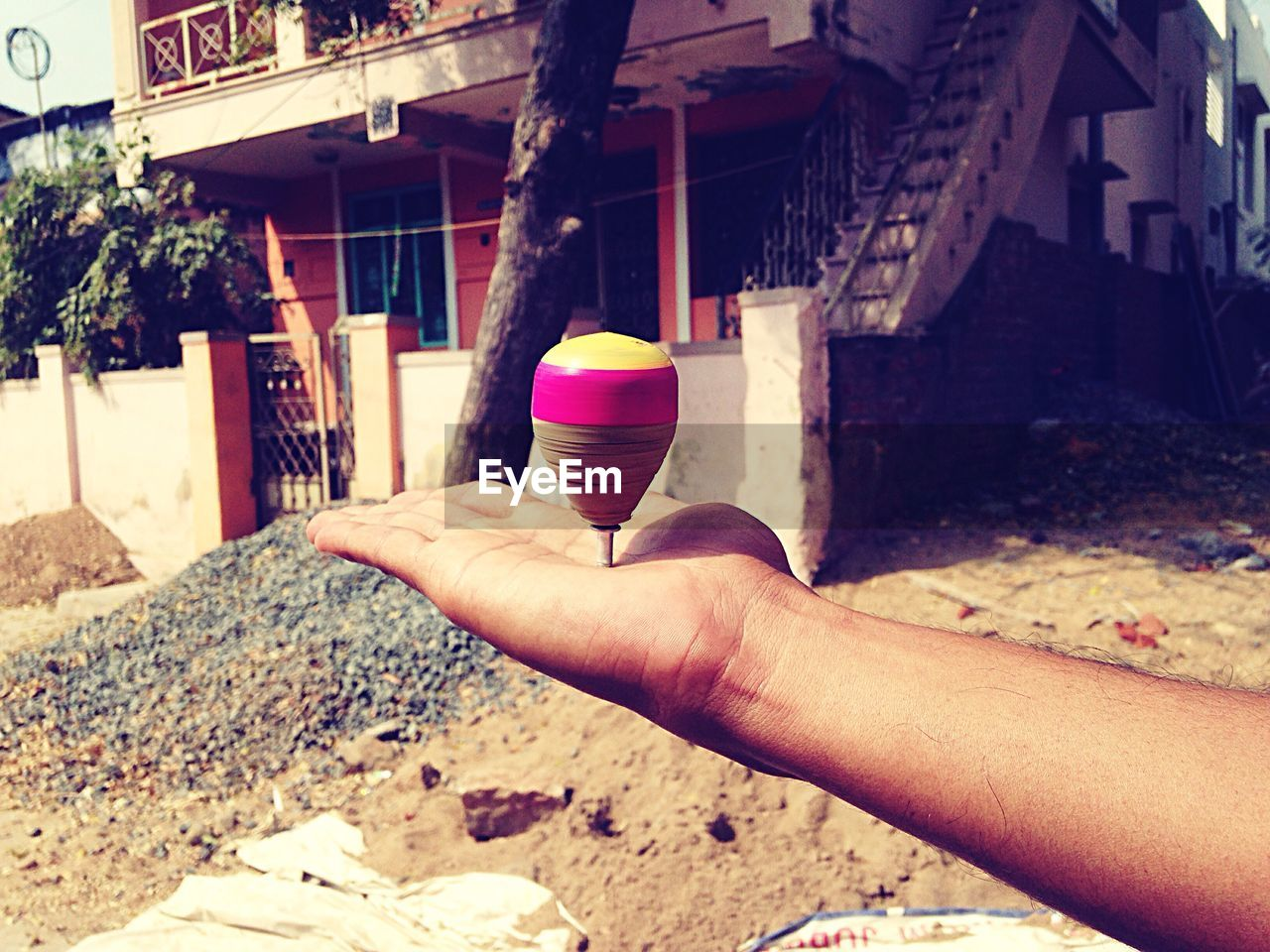 human hand, hand, human body part, built structure, real people, one person, building exterior, architecture, holding, day, focus on foreground, personal perspective, lifestyles, body part, men, nature, outdoors, finger, building, human limb