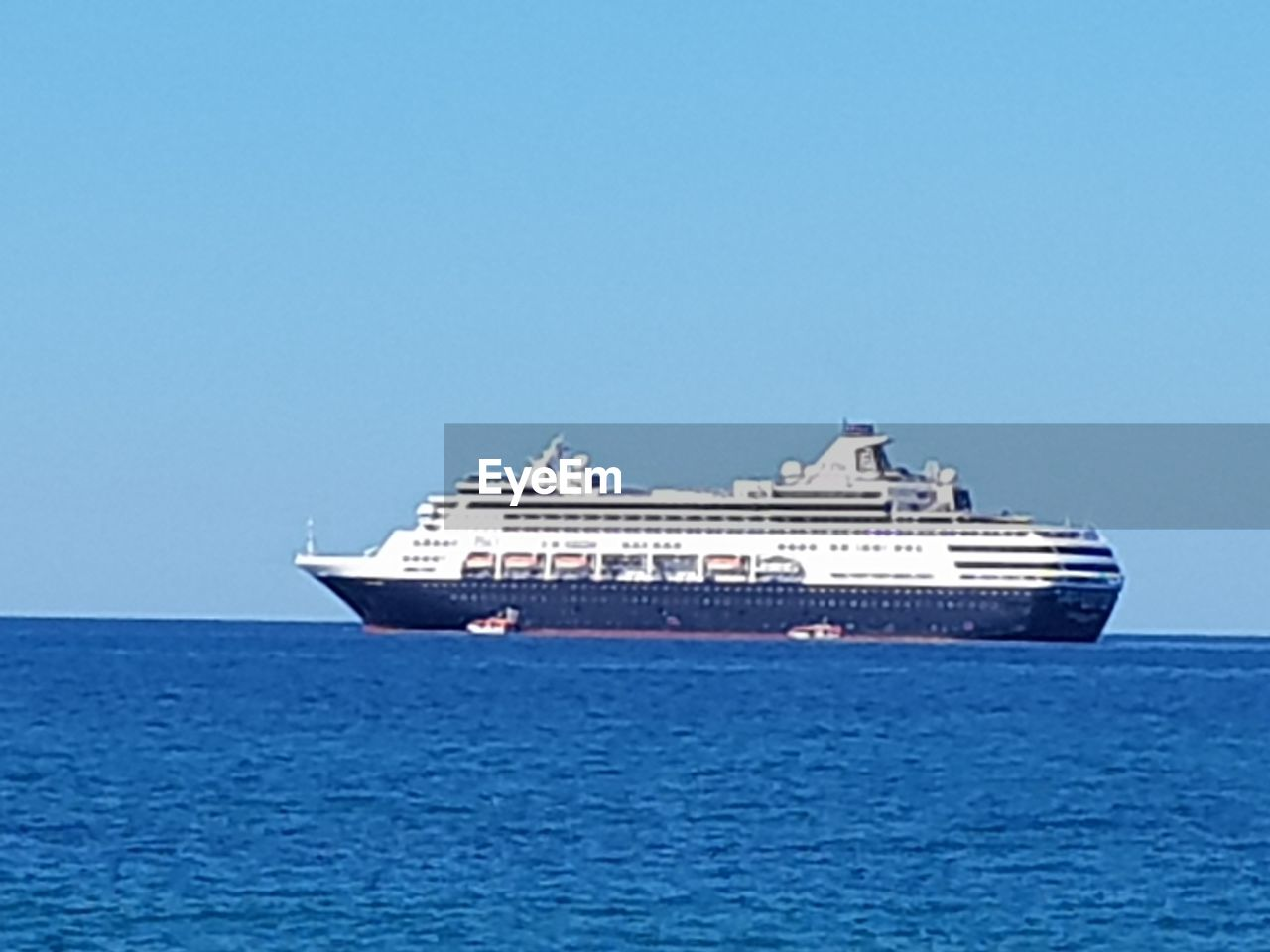 nautical vessel, sea, transportation, water, mode of transportation, sky, ship, blue, copy space, clear sky, cruise, no people, cruise ship, nature, travel, day, craft, sailing, waterfront, horizon over water, passenger craft, luxury, yacht