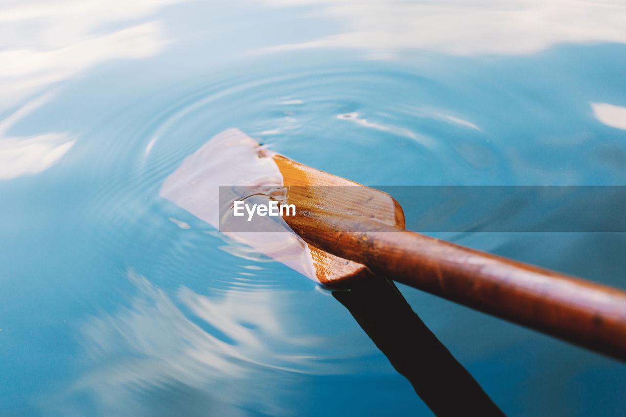 Close-up of oar in water
