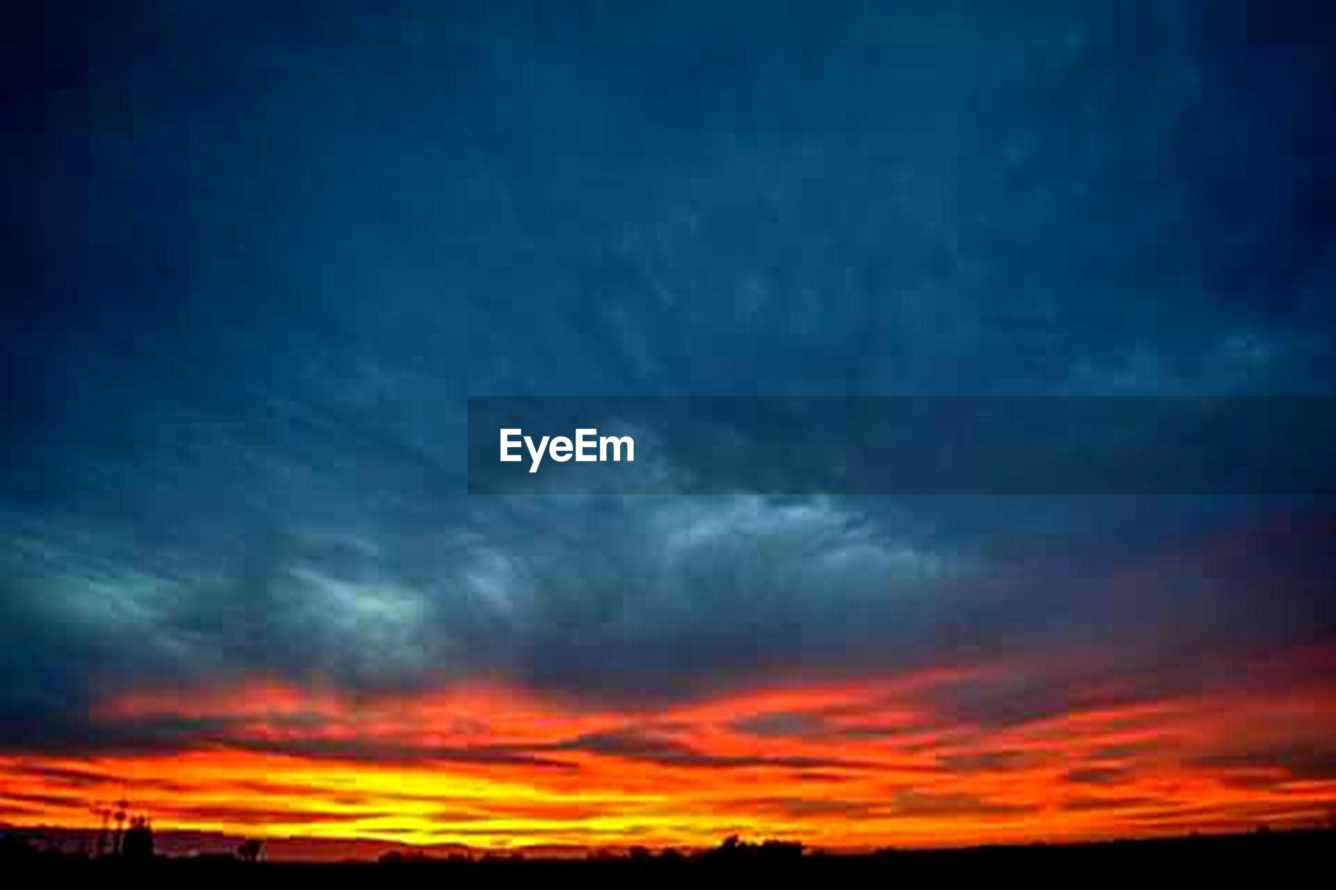 sunset, sky, scenics, silhouette, orange color, beauty in nature, tranquil scene, tranquility, dramatic sky, cloud - sky, nature, idyllic, cloud, moody sky, low angle view, cloudy, atmospheric mood, majestic, landscape, weather