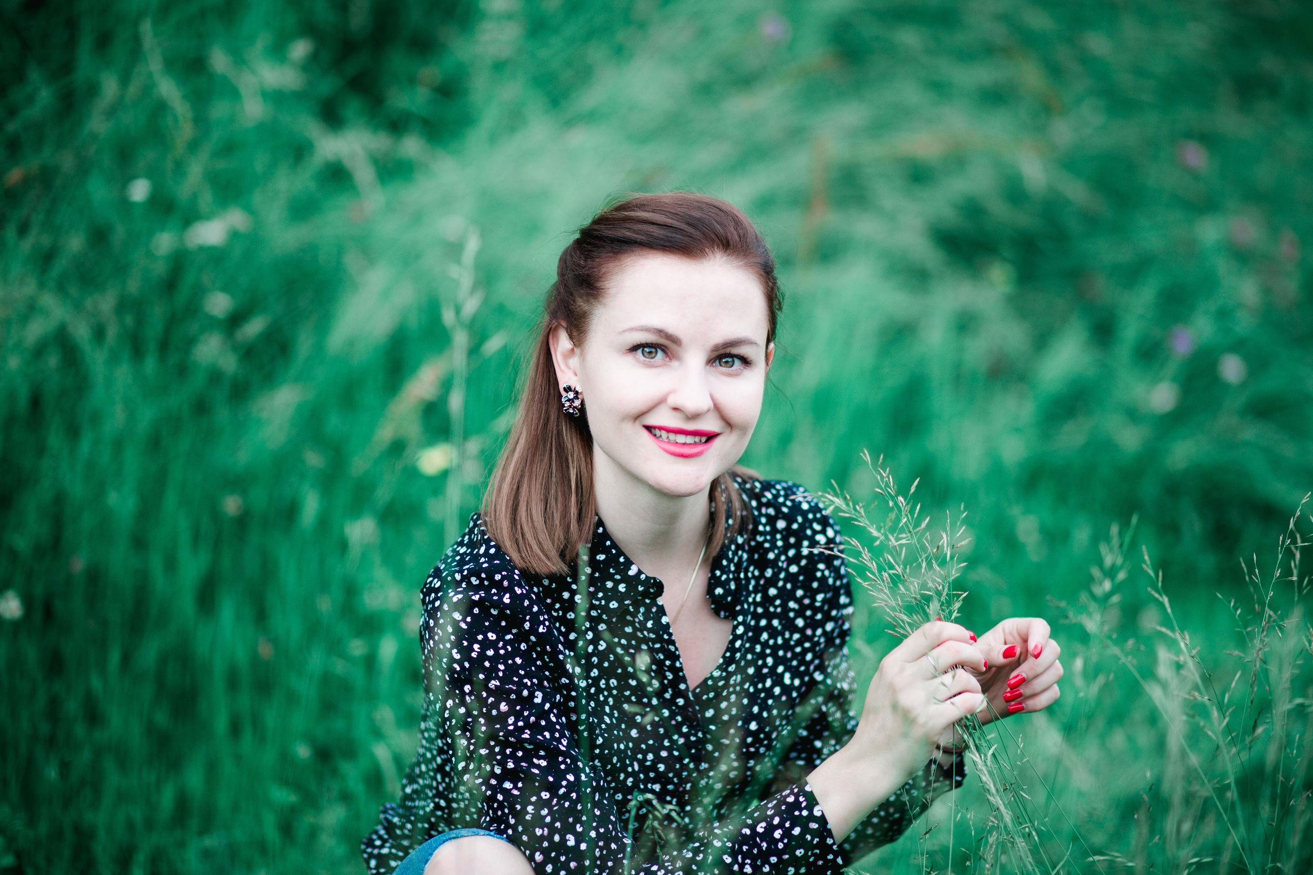 Portrait of smiling beautiful woman sitting amidst plants