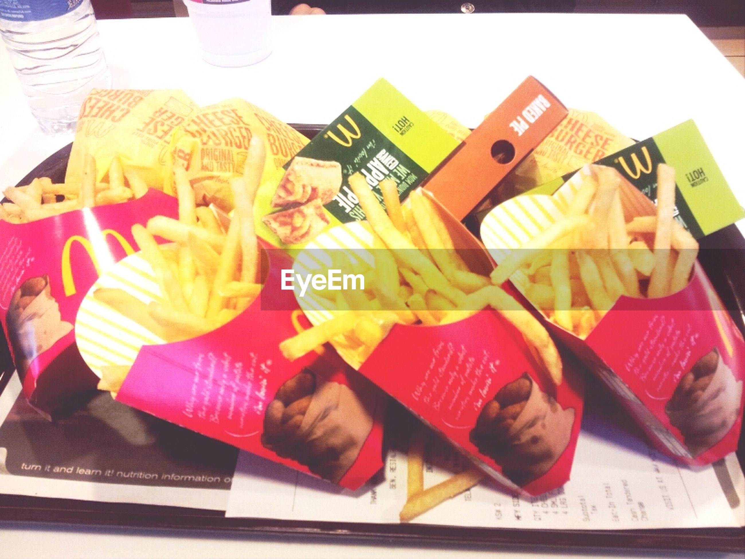 indoors, communication, text, food and drink, paper, western script, book, variation, still life, table, food, holding, learning, choice, high angle view, freshness, education