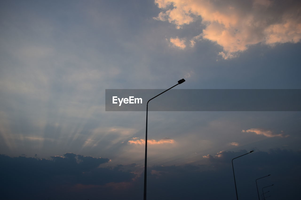 cloud - sky, sky, sunset, technology, low angle view, silhouette, beauty in nature, lighting equipment, no people, street light, nature, street, scenics - nature, orange color, outdoors, electricity, tranquility, idyllic, tranquil scene, electrical equipment, power supply