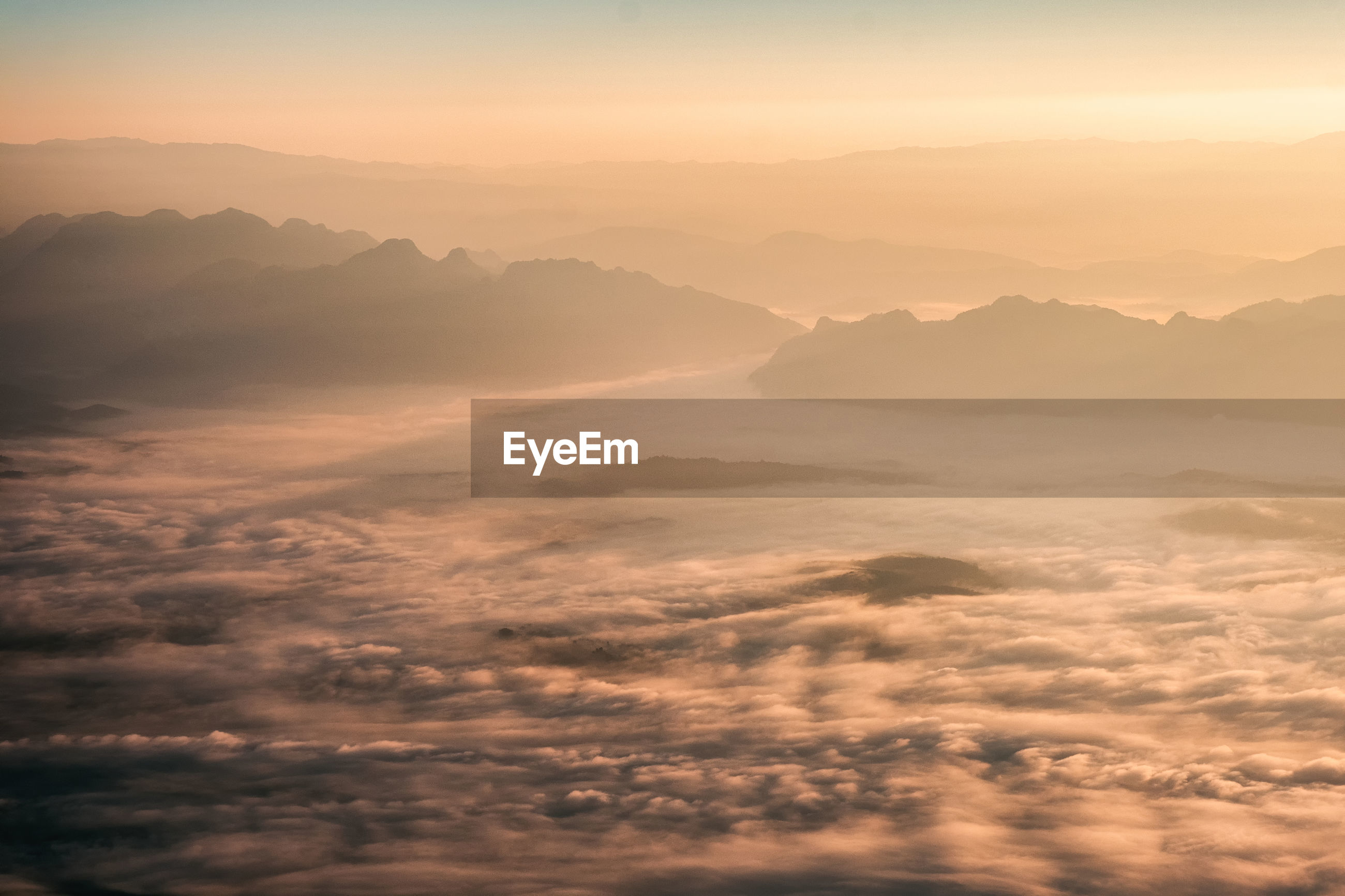 Aerial view of mountains against sky during sunset