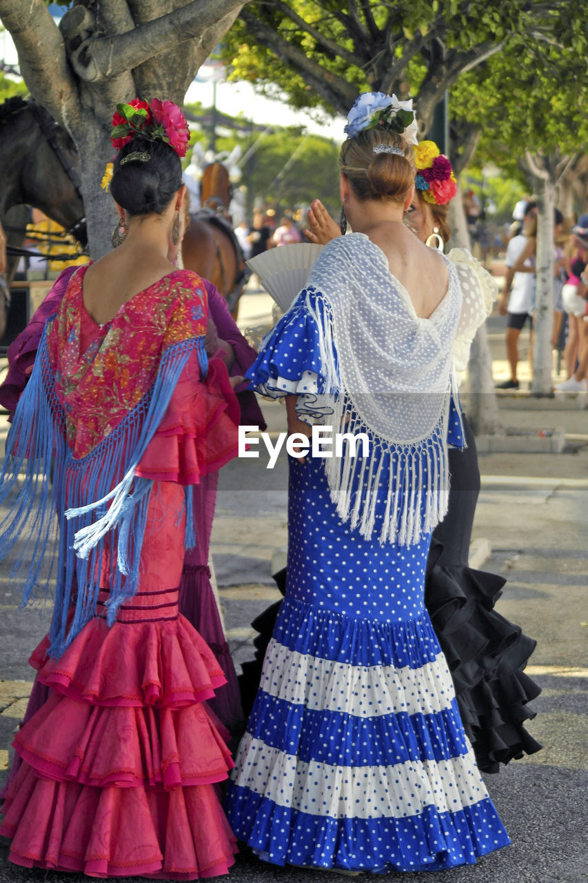 Rear view of women wearing traditional clothing