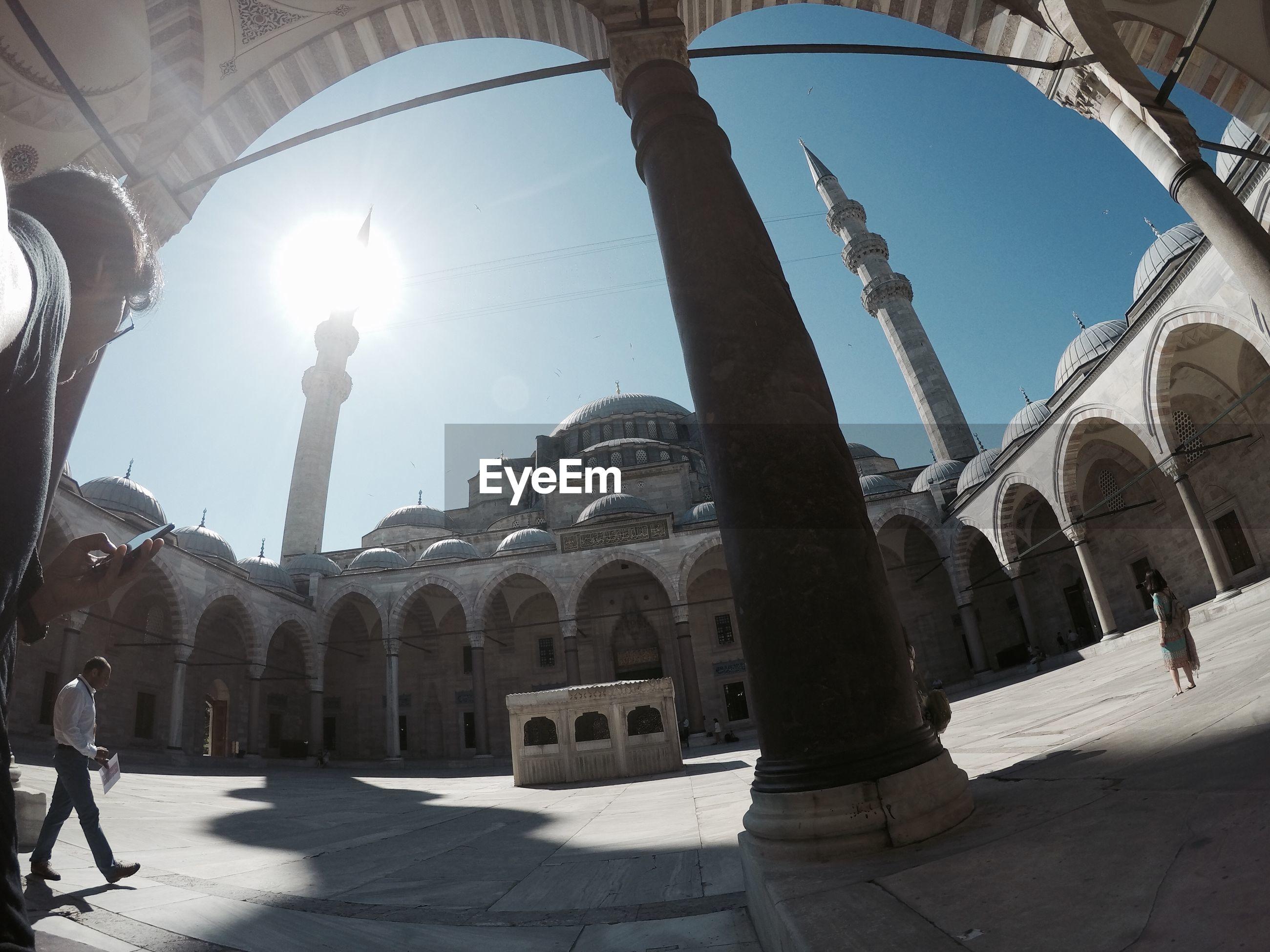 Fish-eye lens view of suleymaniye mosque against sky