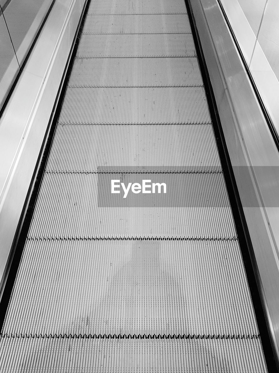 architecture, direction, the way forward, railing, transportation, escalator, no people, high angle view, convenience, metal, indoors, moving walkway, pattern, modern, built structure, day, technology, futuristic