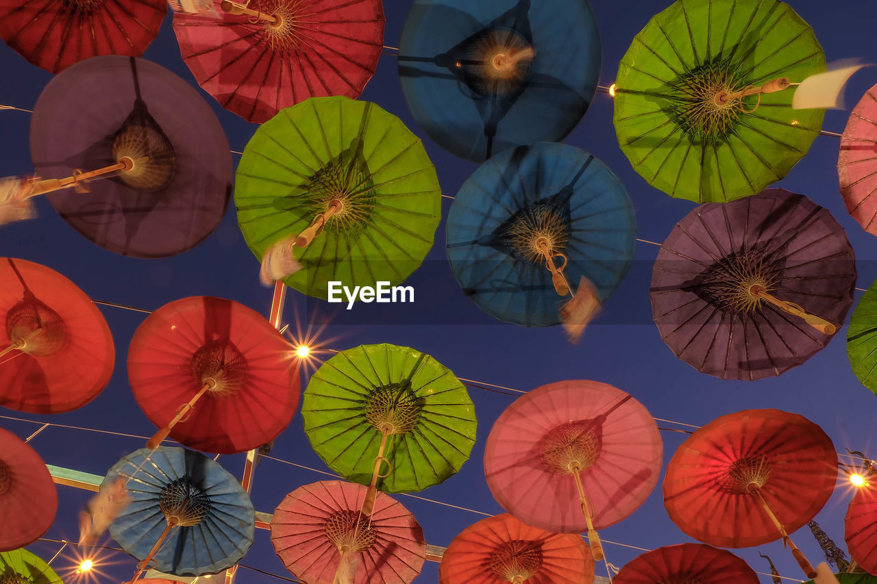 umbrella, large group of objects, low angle view, no people, full frame, multi colored, protection, pattern, day, hanging, security, abundance, decoration, backgrounds, creativity, choice, nature, outdoors