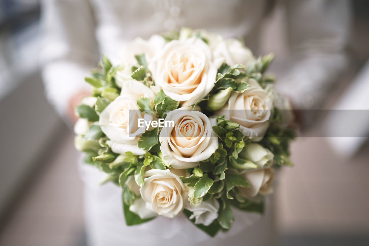 CLOSE-UP OF ROSE BOUQUET ON WHITE ROSES
