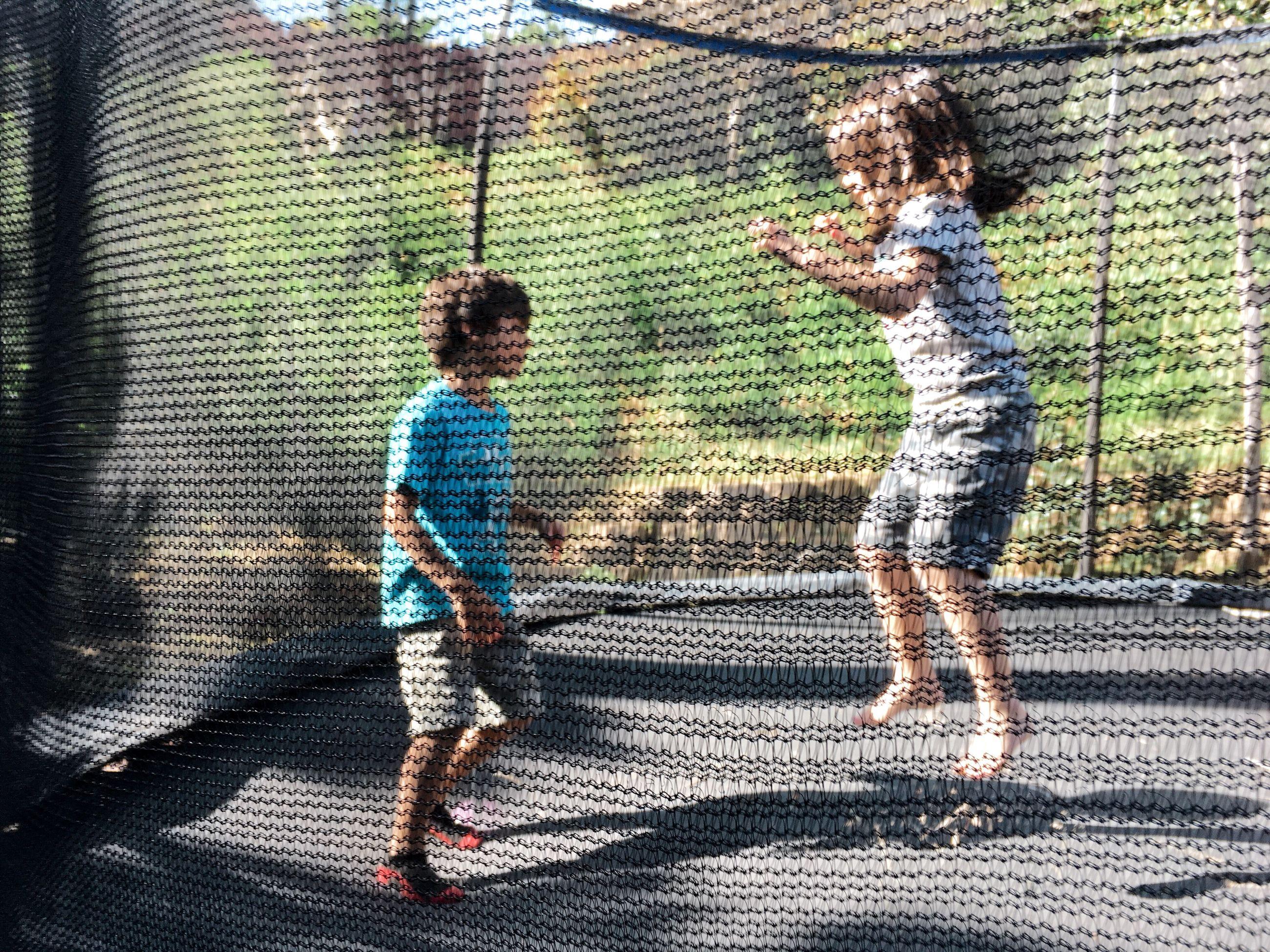 Children playing in trampoline