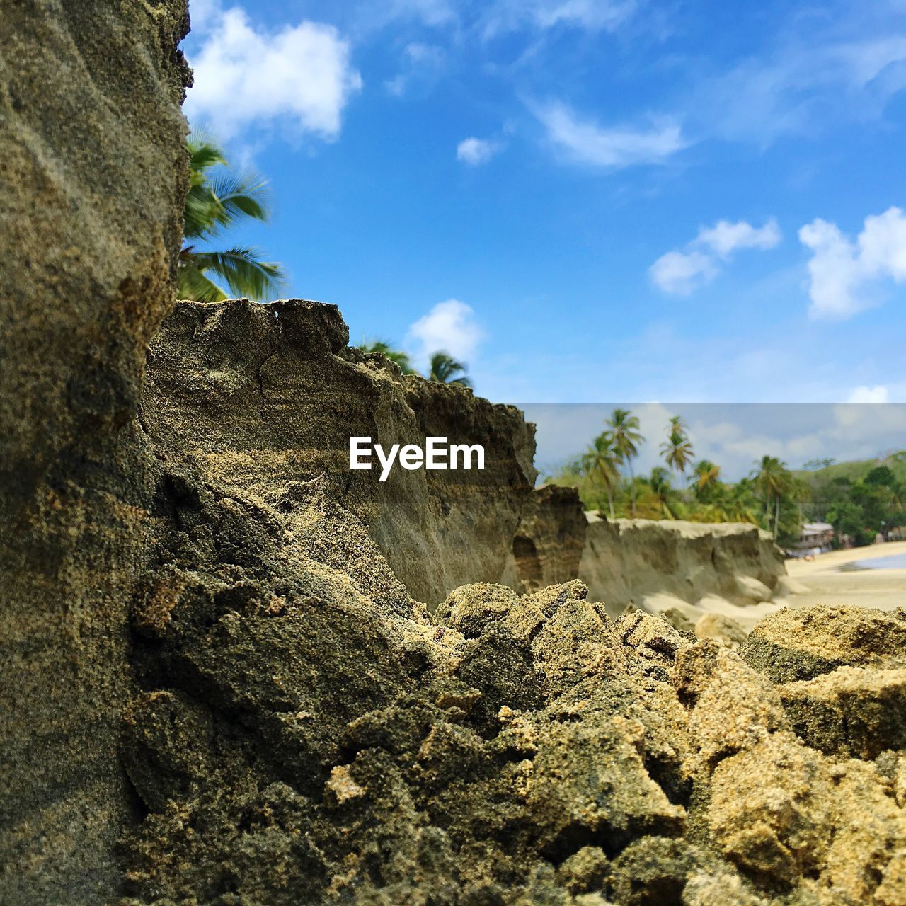 sky, nature, rock - object, day, cloud - sky, tranquil scene, beauty in nature, outdoors, low angle view, no people, scenics, tree, tranquility, physical geography, blue, landscape, cliff, mountain, animal themes