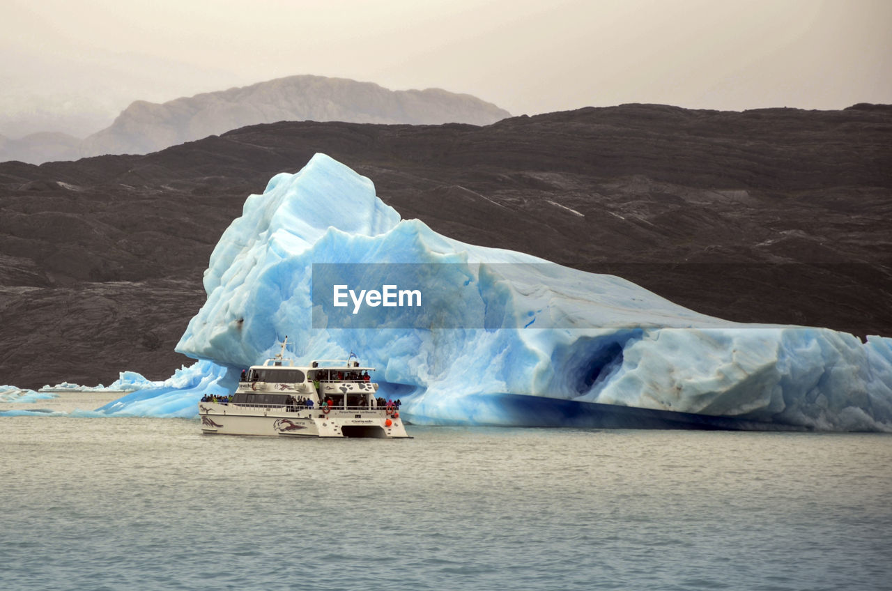 mountain, waterfront, nature, glacier, water, scenics, no people, beauty in nature, outdoors, day, sea, iceberg, glacial