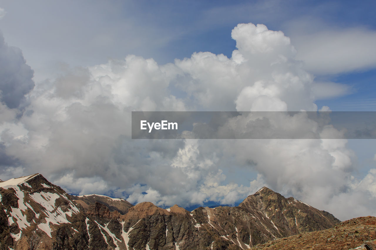 PANORAMIC VIEW OF CLOUDS OVER MOUNTAINS