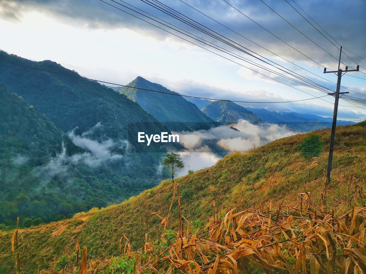 mountain, scenics - nature, beauty in nature, sky, cable, cloud - sky, tranquil scene, landscape, electricity, tranquility, environment, no people, nature, non-urban scene, mountain range, technology, day, connection, power line, electricity pylon, outdoors, power supply