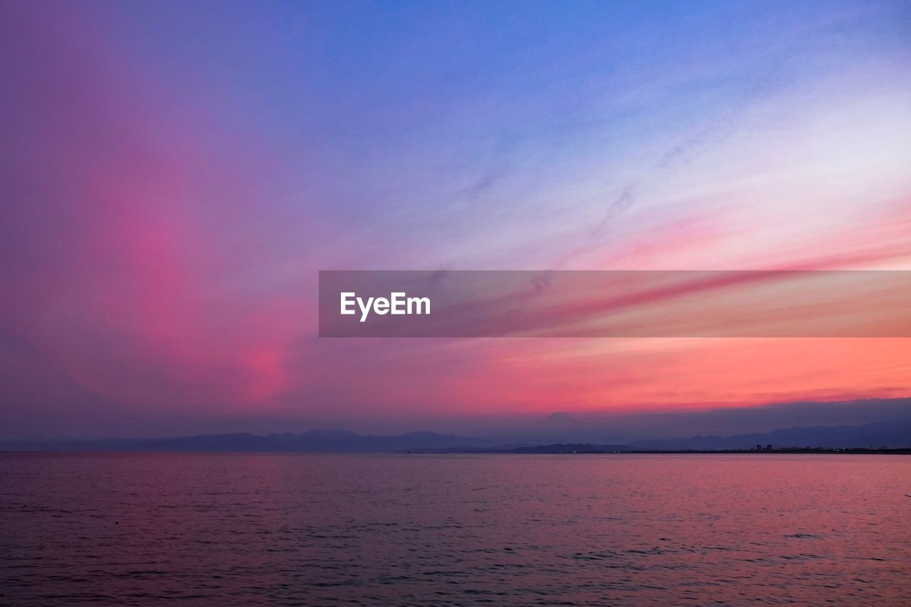 beauty in nature, sky, scenics - nature, sunset, tranquil scene, tranquility, water, idyllic, orange color, sea, cloud - sky, no people, waterfront, nature, non-urban scene, horizon, remote, outdoors, horizon over water, romantic sky, purple