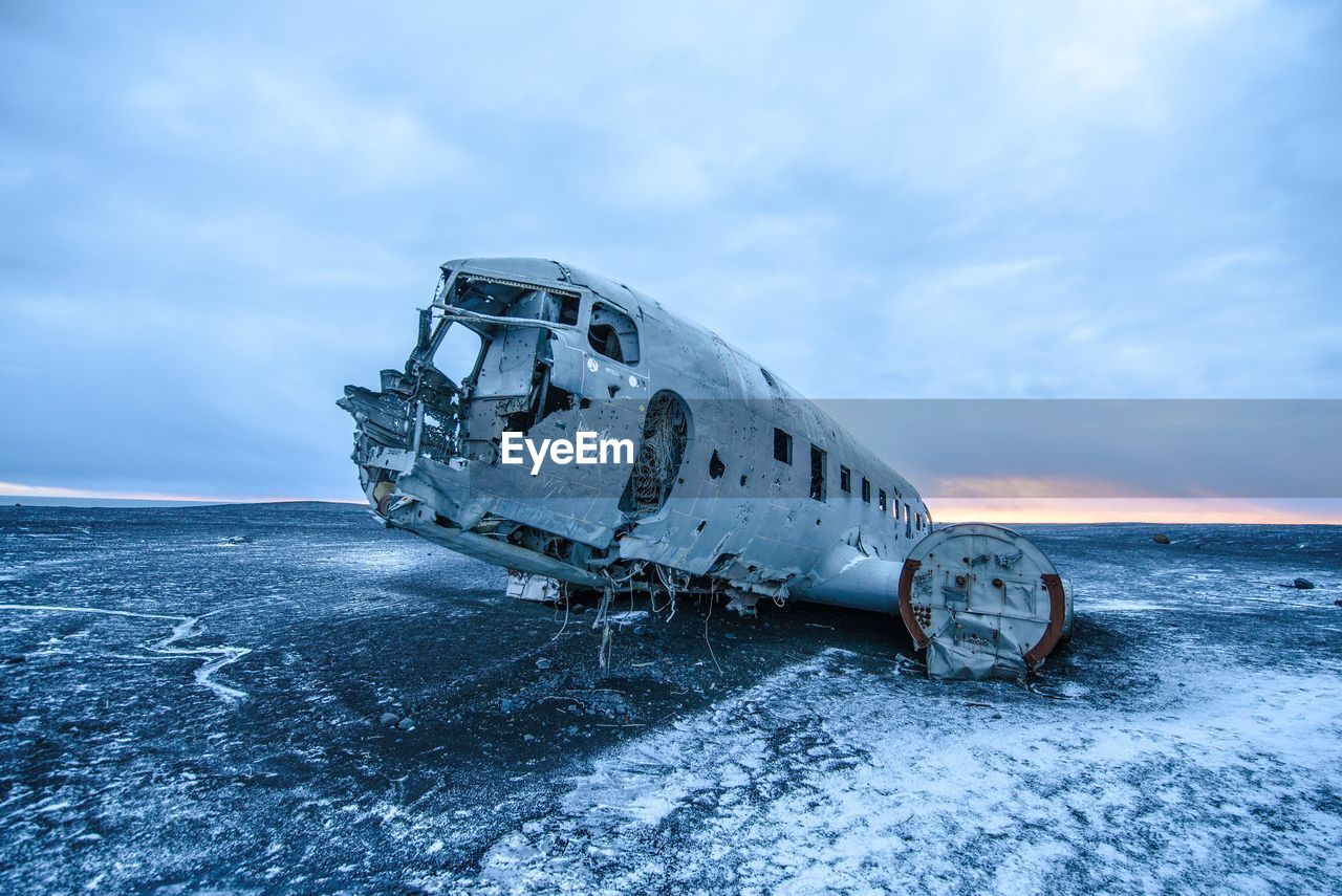 Abandoned Plane On Sea Against Sky During Winter
