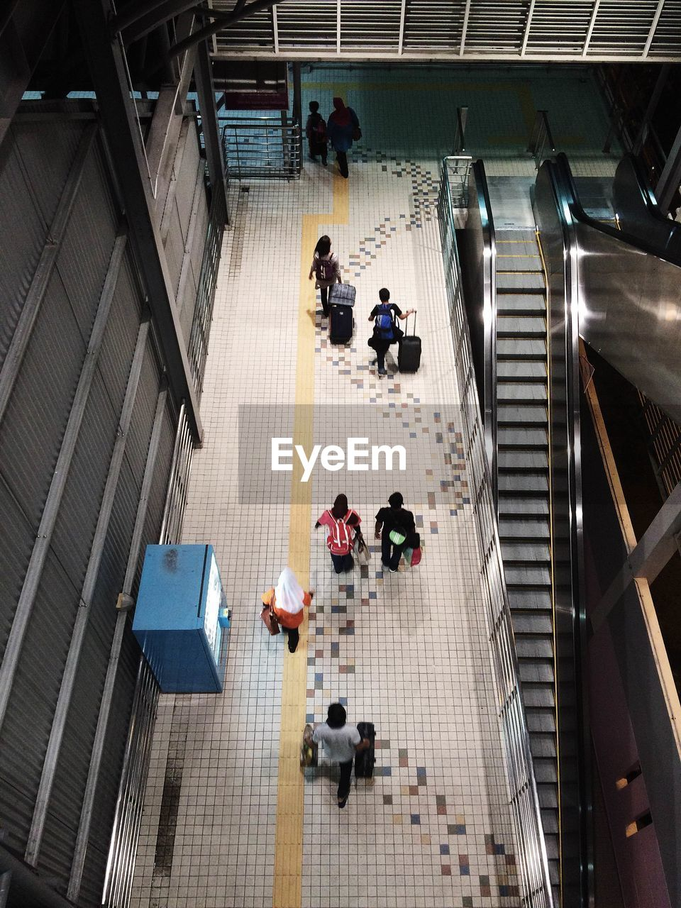 High angle view of people walking in building
