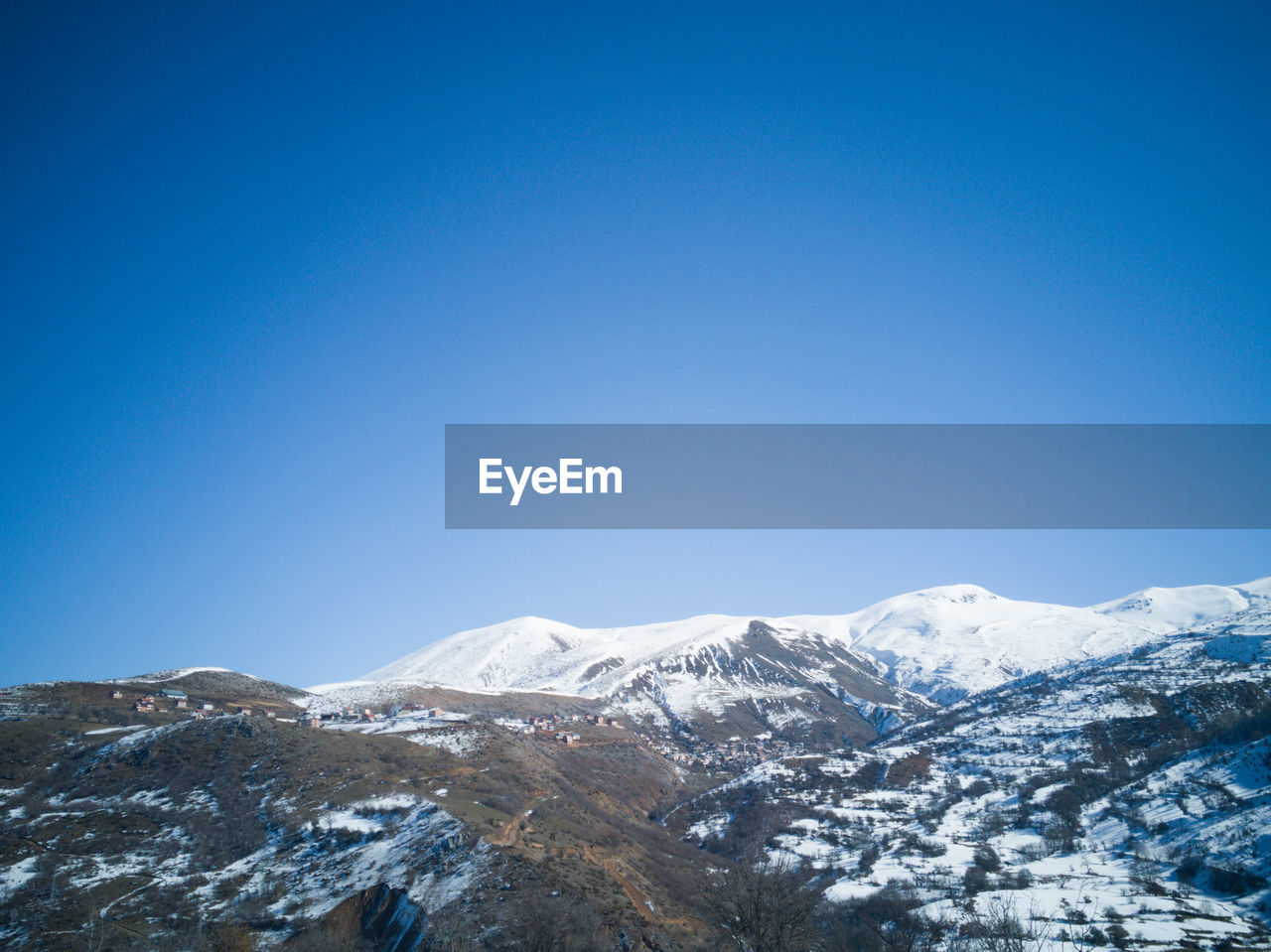 sky, snow, mountain, winter, cold temperature, blue, clear sky, beauty in nature, copy space, scenics - nature, snowcapped mountain, tranquility, tranquil scene, nature, mountain range, day, environment, no people, non-urban scene, mountain peak, outdoors