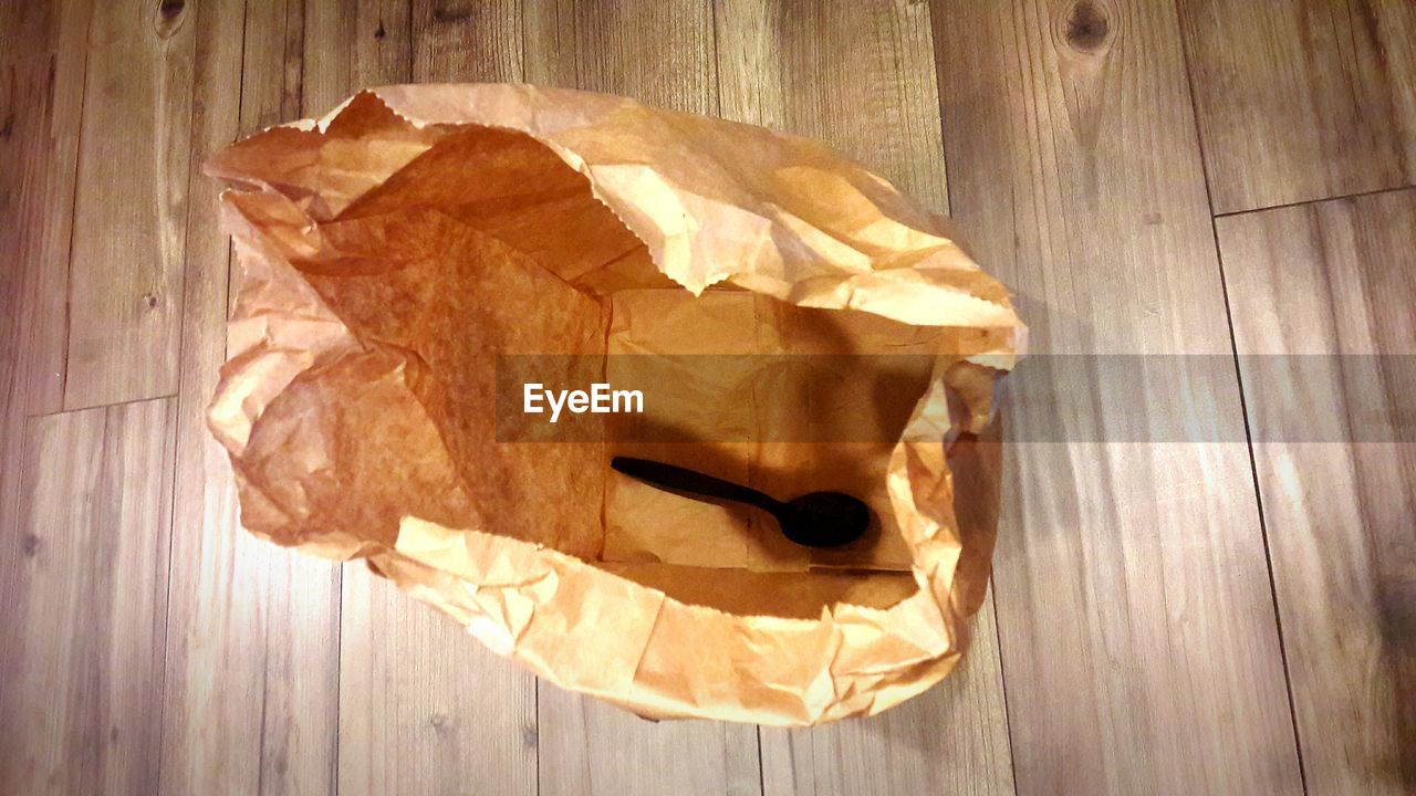 table, wood - material, no people, indoors, crumpled, paper, food, crumpled paper, close-up, day