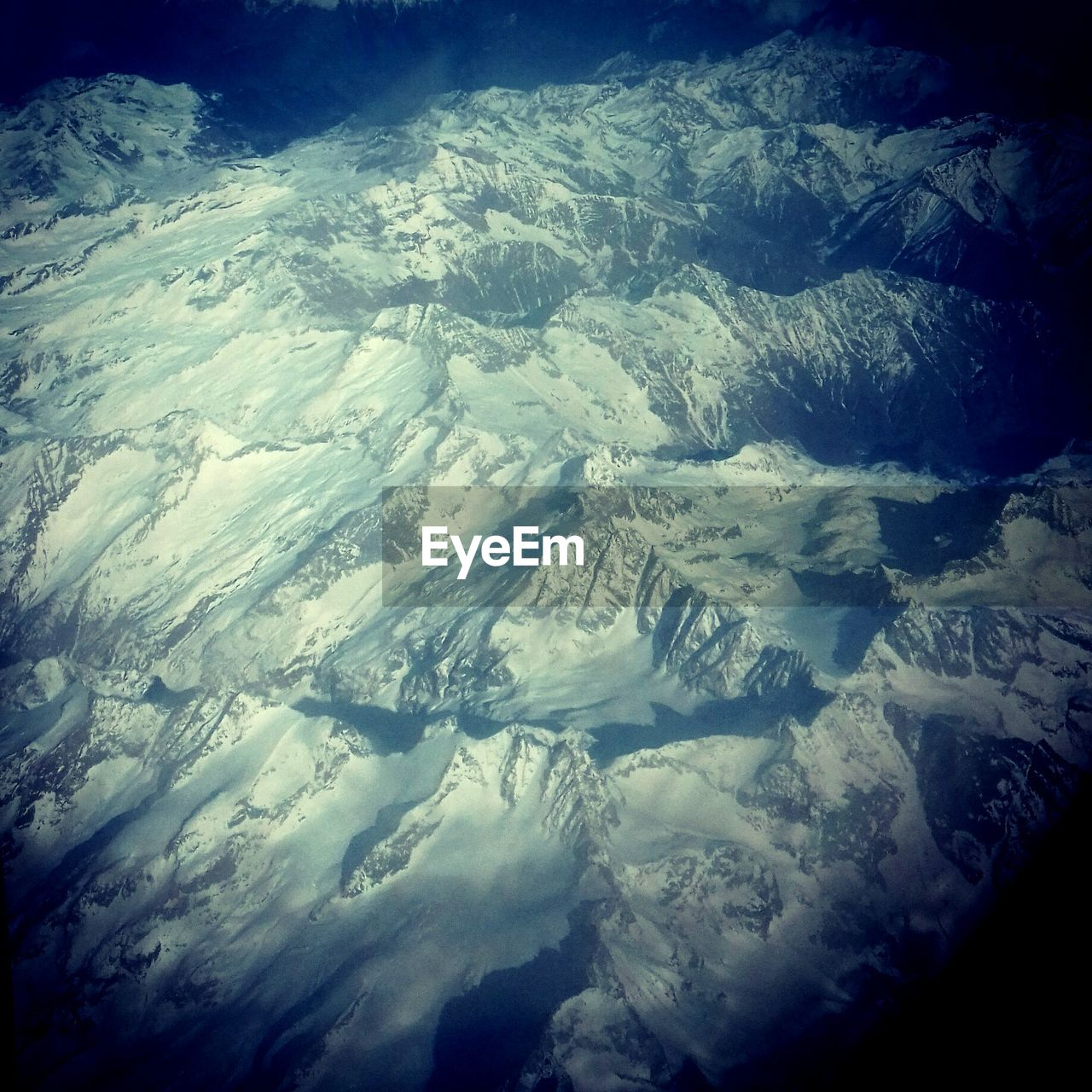 weather, aerial view, landscape, nature, cold temperature, extreme weather, beauty in nature, snow, scenics, outdoors, day, no people, backgrounds, tranquility, winter, power in nature, mountain, satellite view