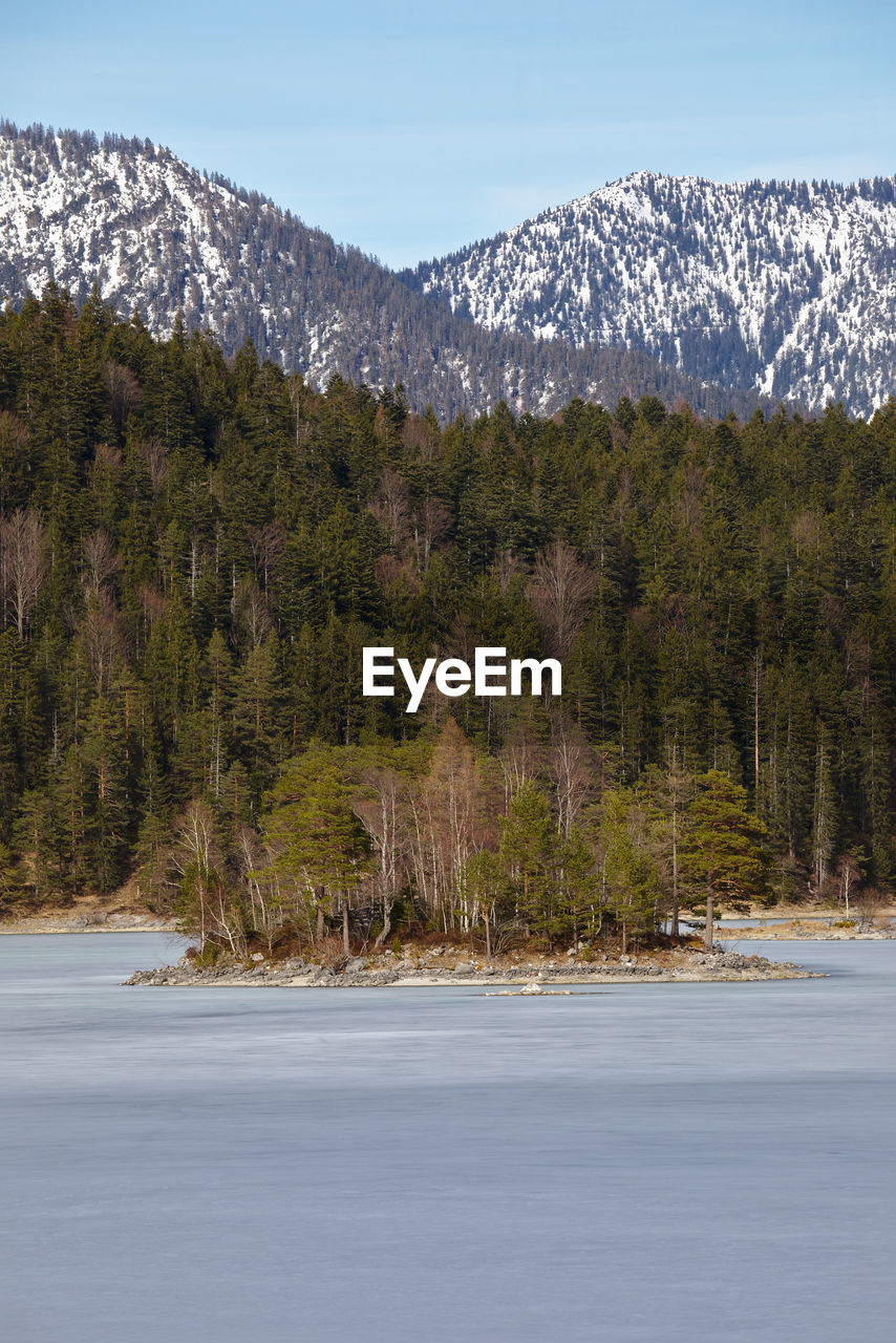 Eibsee Frozen Lake Beauty In Nature Cold Temperature Day Frozen Water Growth Lake Land Mountain Mountain Range Nature No People Non-urban Scene Outdoors Plant Scenics - Nature Sky Snow Snowcapped Mountain Tranquil Scene Tranquility Tree Water Winter