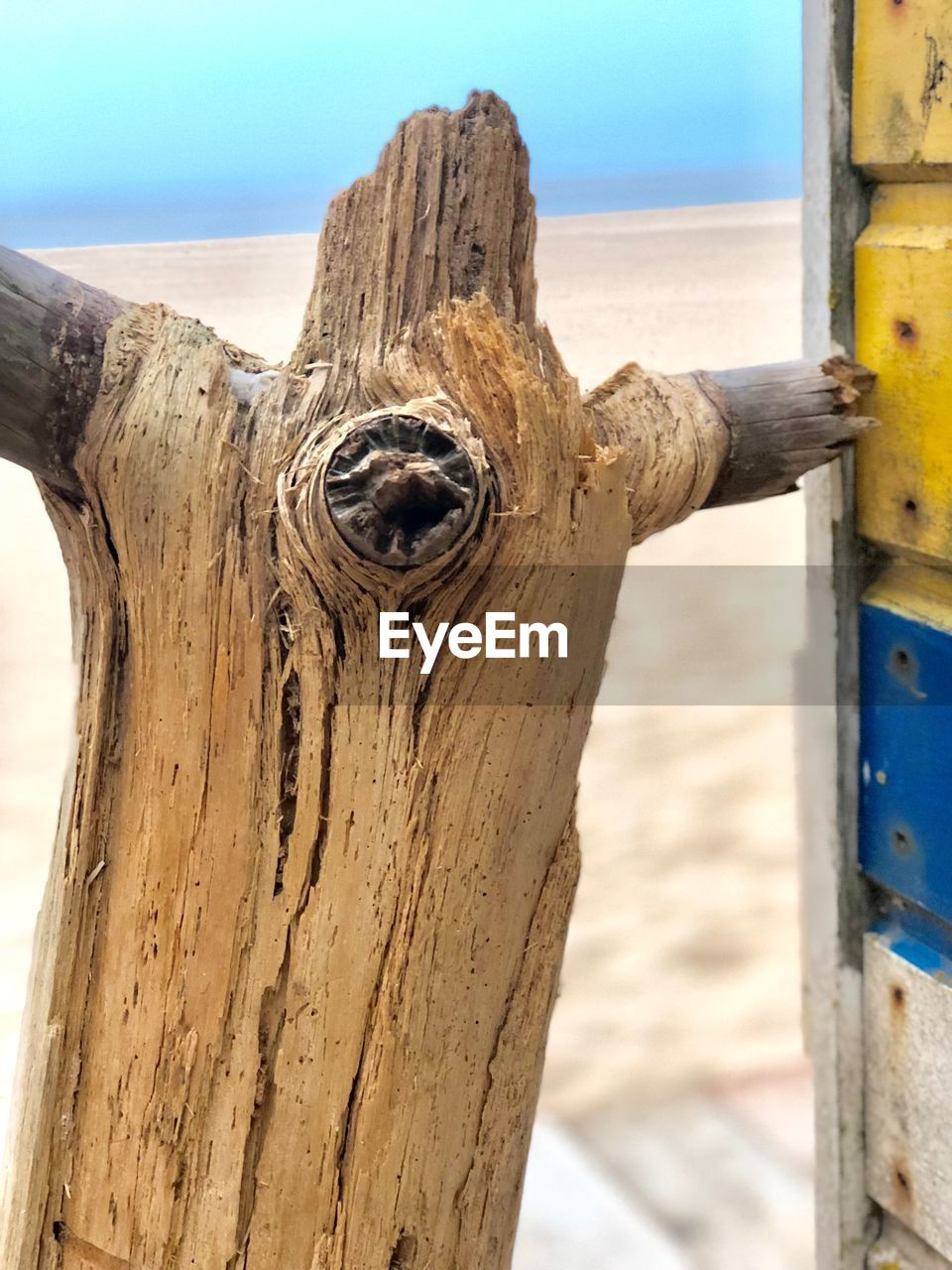 wood - material, focus on foreground, day, close-up, no people, metal, post, wooden post, outdoors, nature, weathered, textured, old, sky, security, sea, rusty, protection, safety, wood, nail