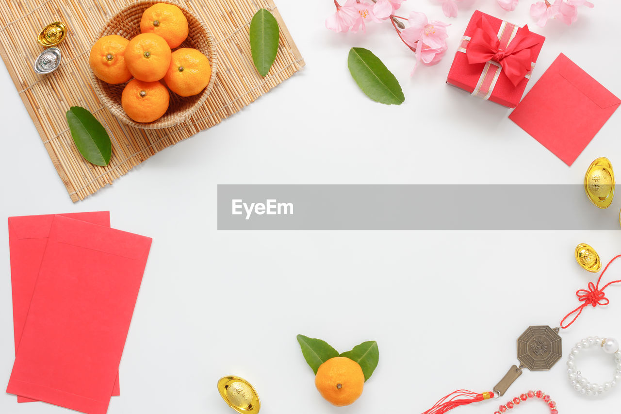 High Angle View Of Fruits And Gifts On Table