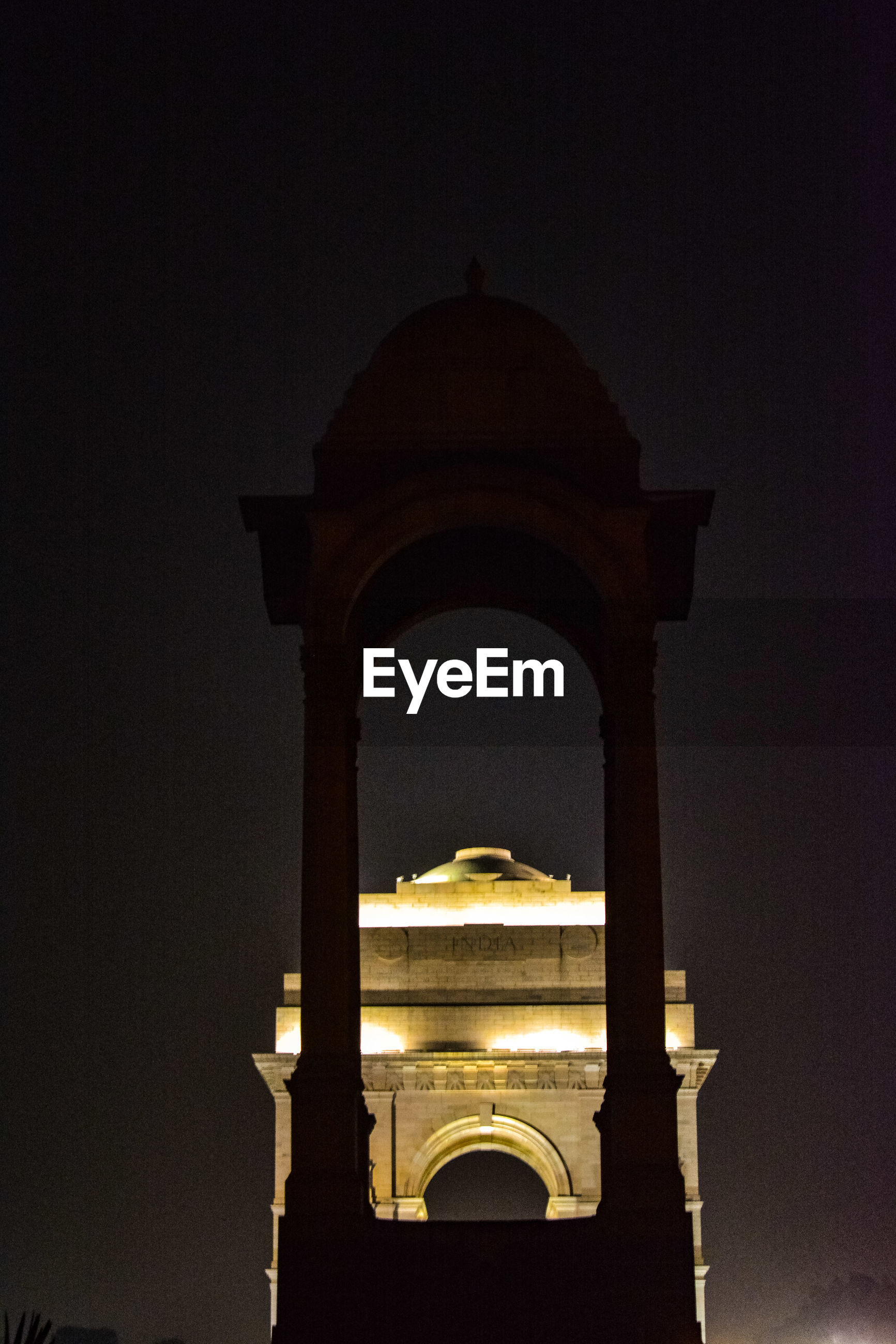 LOW ANGLE VIEW OF MOSQUE AGAINST SKY AT NIGHT