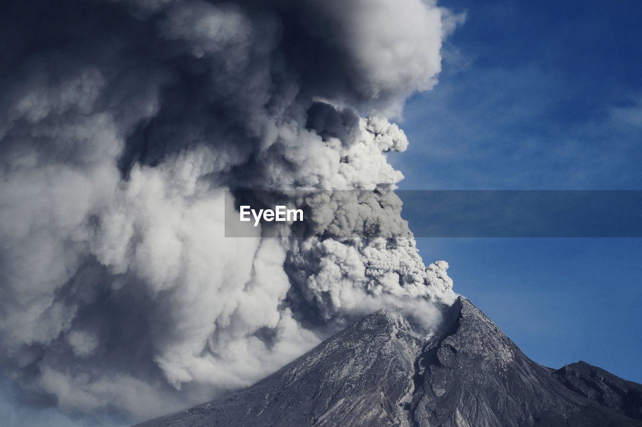 Smoke emitting from volcanic eruption, mt. merapi - indonesia