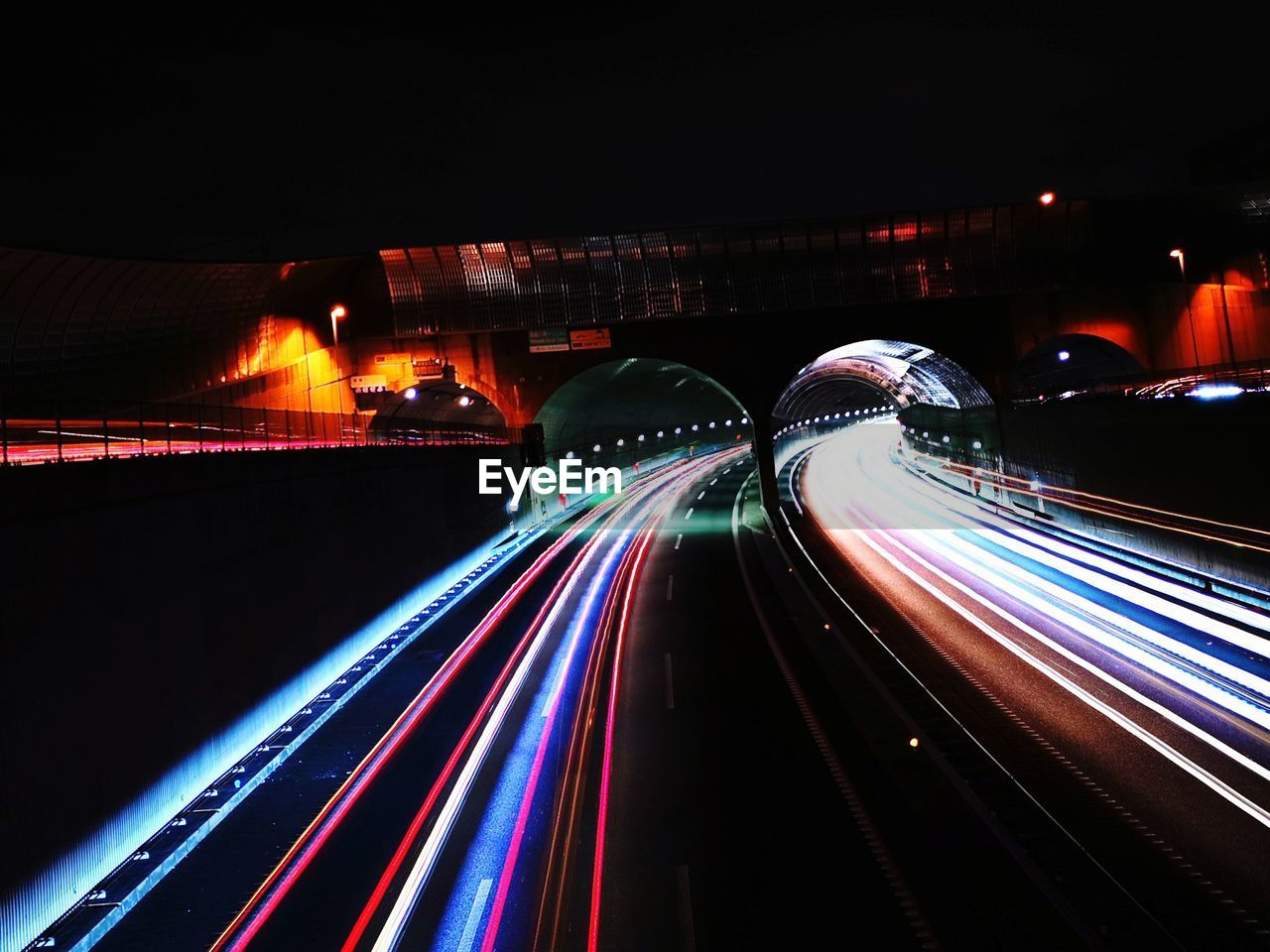long exposure, illuminated, motion, night, light trail, speed, transportation, blurred motion, multi colored, architecture, no people, glowing, built structure, road, tail light, city, connection, the way forward, light - natural phenomenon, highway