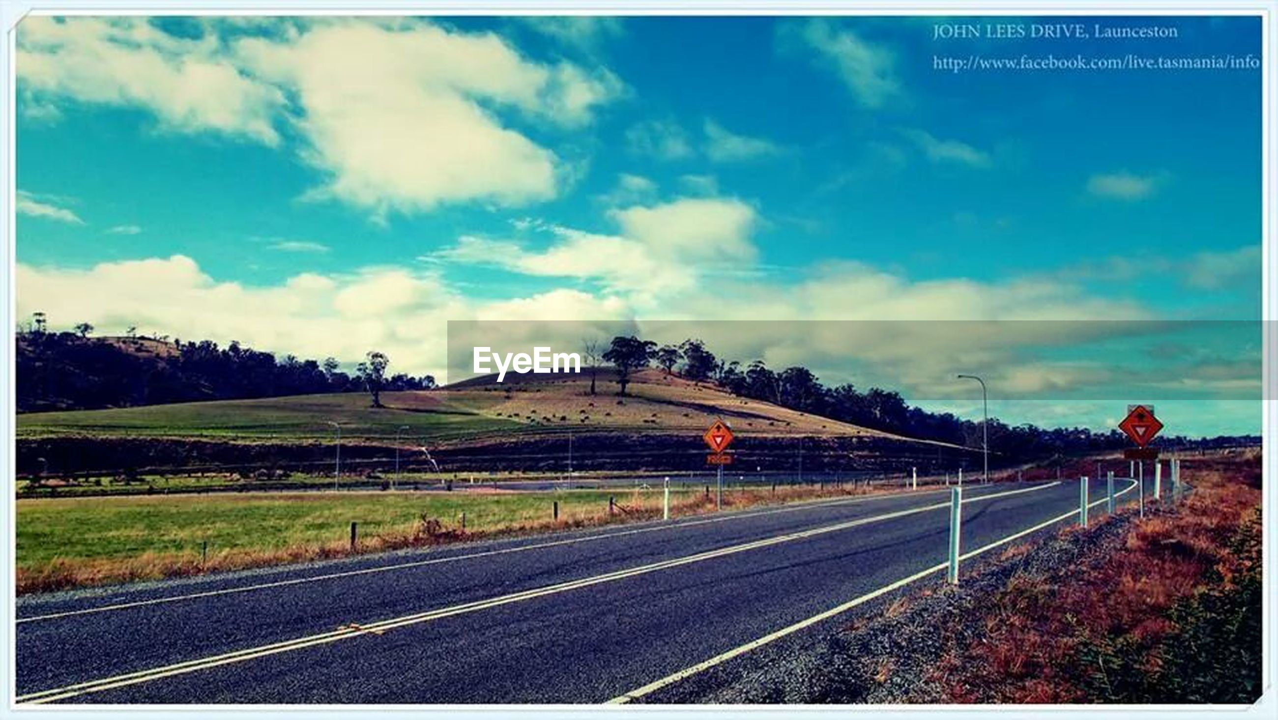 transportation, transfer print, sky, railroad track, auto post production filter, road, the way forward, cloud - sky, road marking, diminishing perspective, rail transportation, cloud, vanishing point, blue, landscape, field, outdoors, tree, cloudy, day