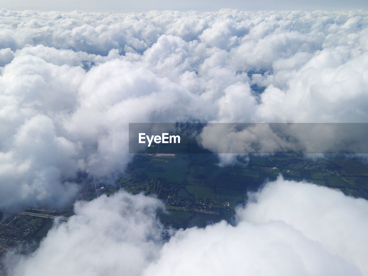 HIGH ANGLE VIEW OF CLOUDS OVER LANDSCAPE