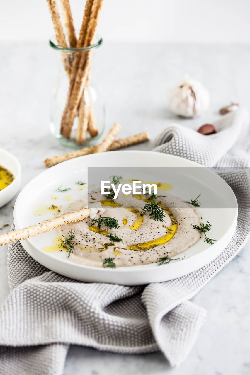 food, food and drink, eating utensil, kitchen utensil, freshness, ready-to-eat, healthy eating, plate, indoors, table, spoon, wellbeing, vegetable, no people, napkin, close-up, still life, fork, focus on foreground, bowl, herb, garnish, table knife, vegetarian food, place mat