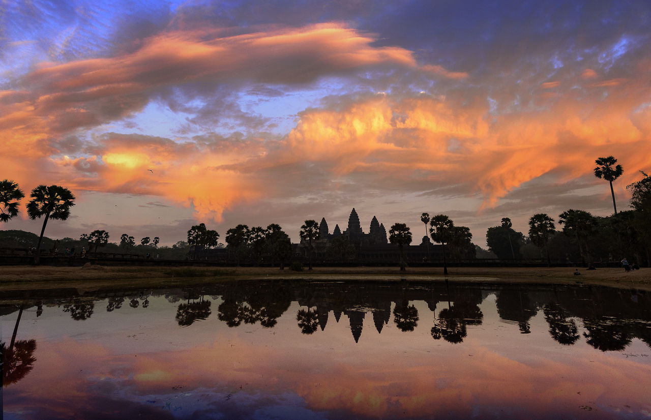 reflection, sky, sunset, water, cloud - sky, beauty in nature, lake, scenics - nature, orange color, tranquility, nature, tree, waterfront, tranquil scene, plant, silhouette, no people, idyllic, non-urban scene