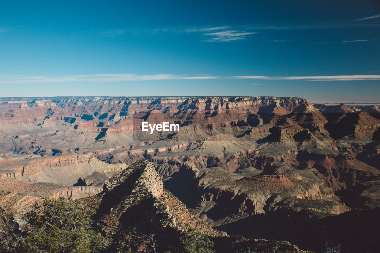 Idyllic view of dramatic landscape against sky at grand canyon national park