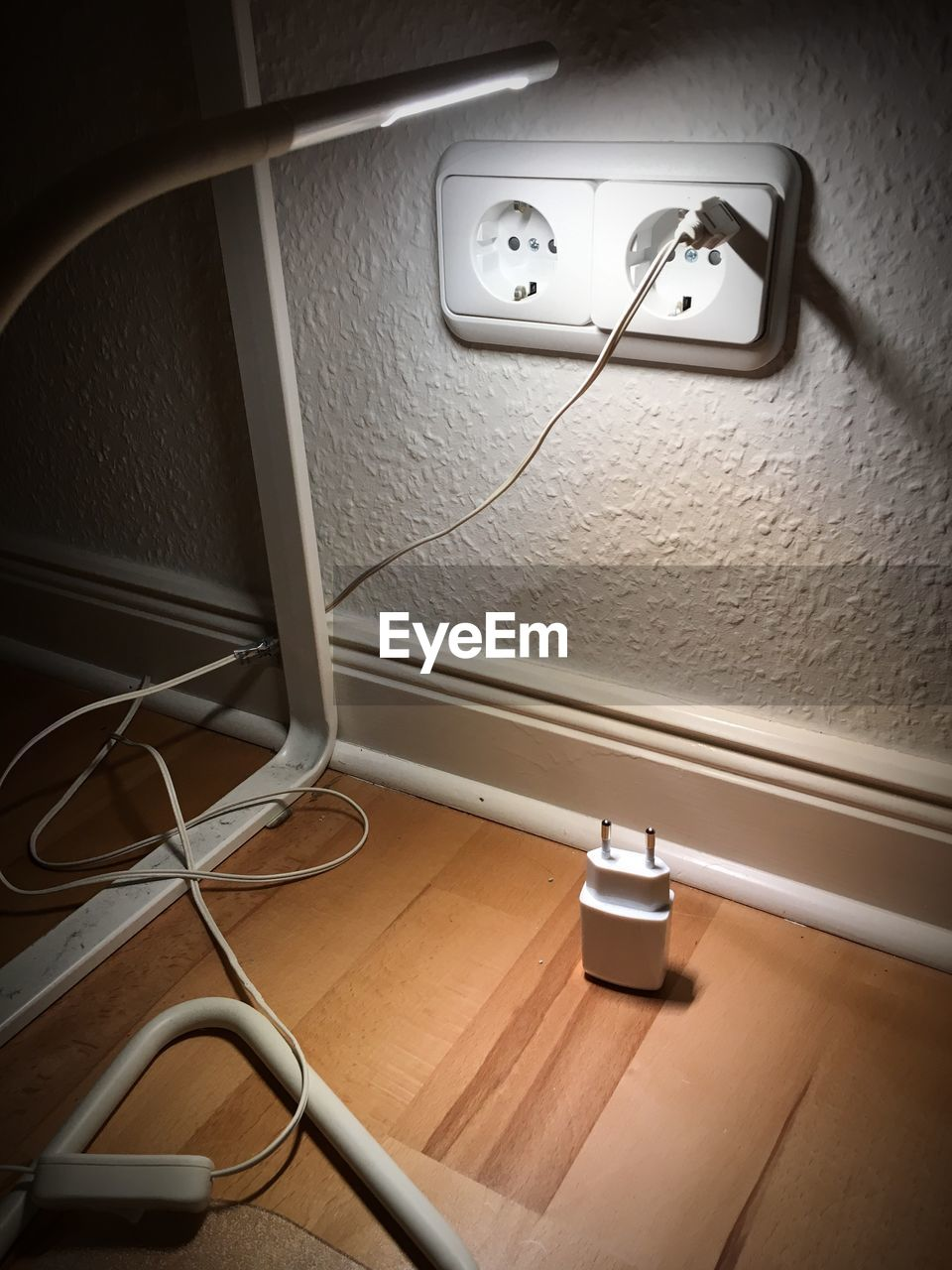 electricity, indoors, cable, technology, wall - building feature, connection, outlet, electric plug, no people, flooring, lighting equipment, power supply, home interior, illuminated, domestic room, fuel and power generation, wall, power line, electric light, bathroom, light, electrical equipment, electric lamp, electrical component
