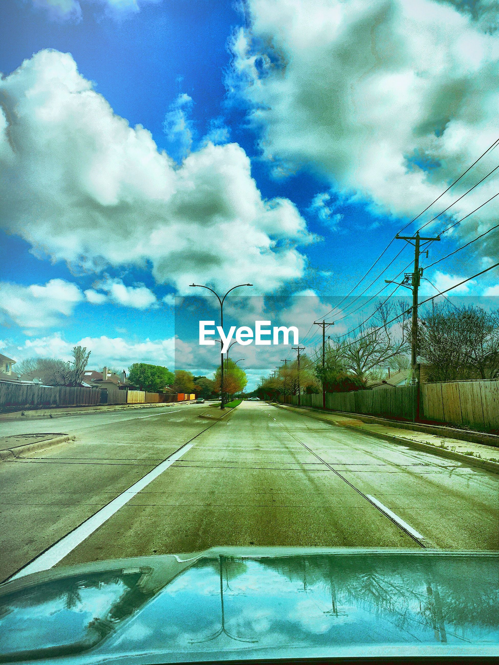 sky, transportation, the way forward, road, cloud - sky, diminishing perspective, vanishing point, cloudy, street, cloud, road marking, car, electricity pylon, empty road, weather, street light, day, blue, country road, land vehicle