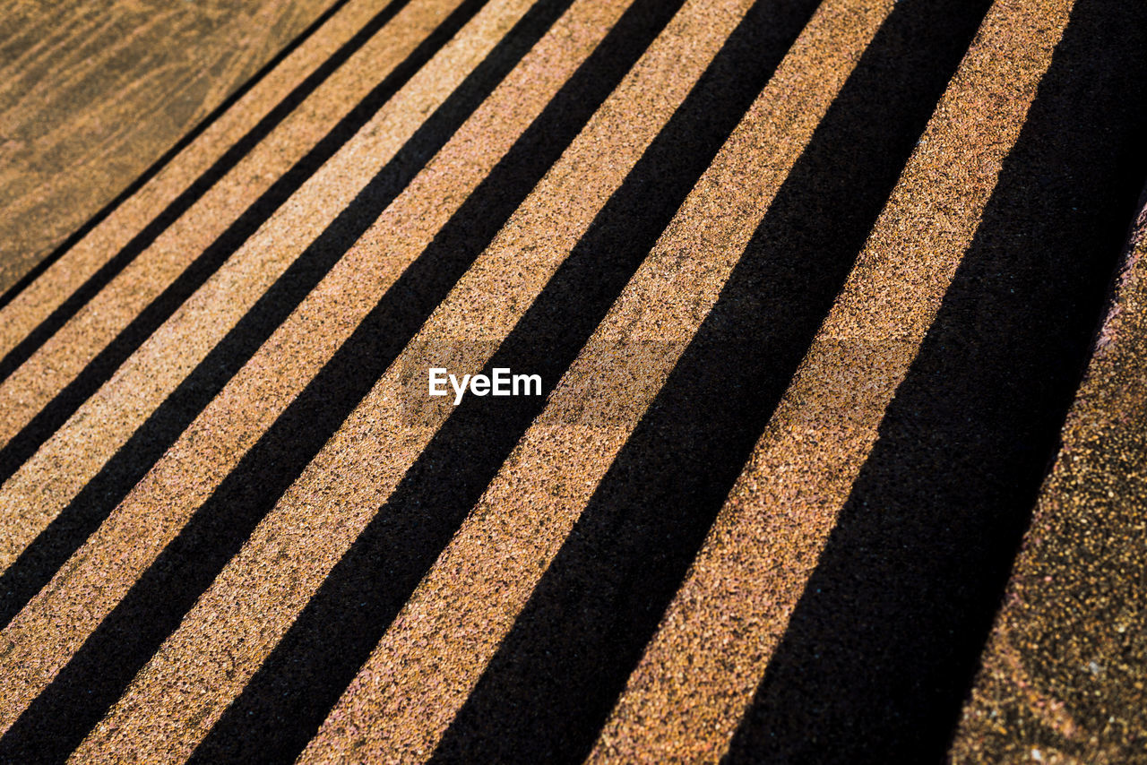 shadow, pattern, sunlight, full frame, no people, nature, day, high angle view, striped, backgrounds, outdoors, focus on shadow, in a row, textured, repetition, close-up, sunny, road, black color, side by side
