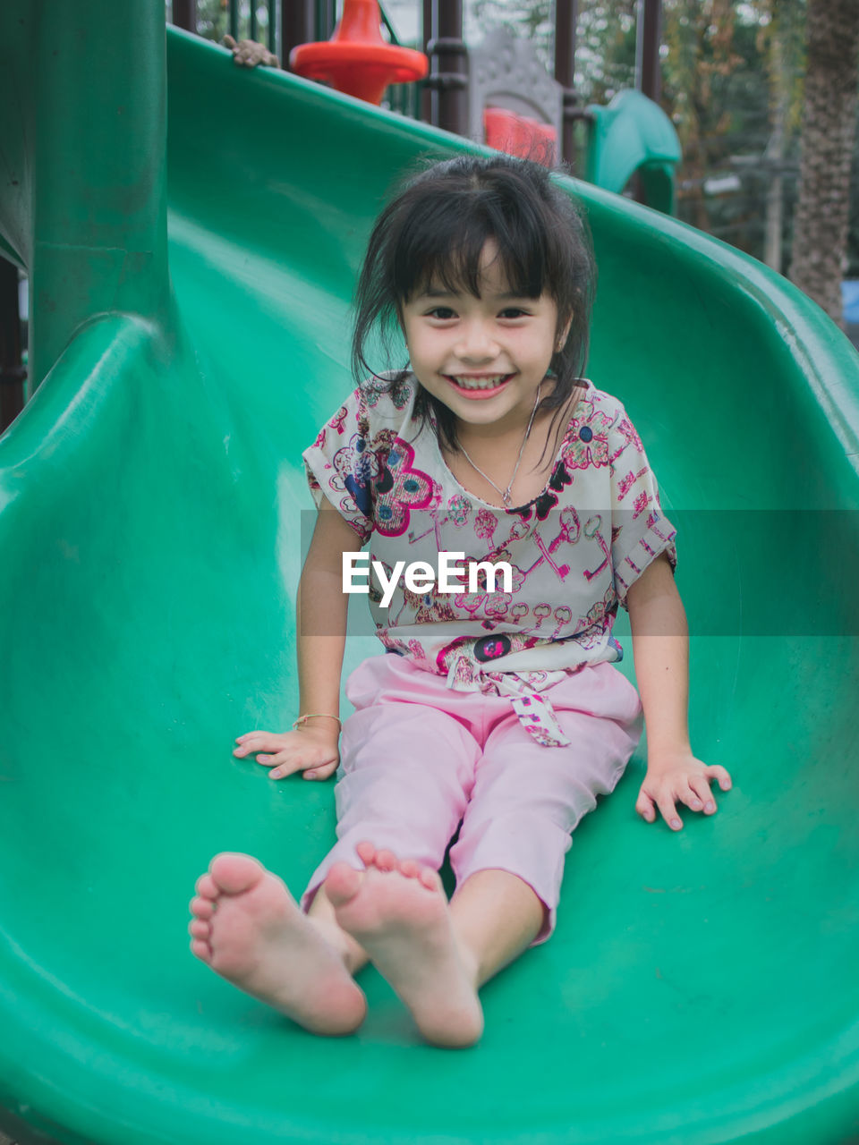 childhood, child, front view, one person, girls, smiling, innocence, happiness, real people, looking at camera, cute, females, full length, women, leisure activity, portrait, casual clothing, playground, playing, outdoor play equipment, outdoors